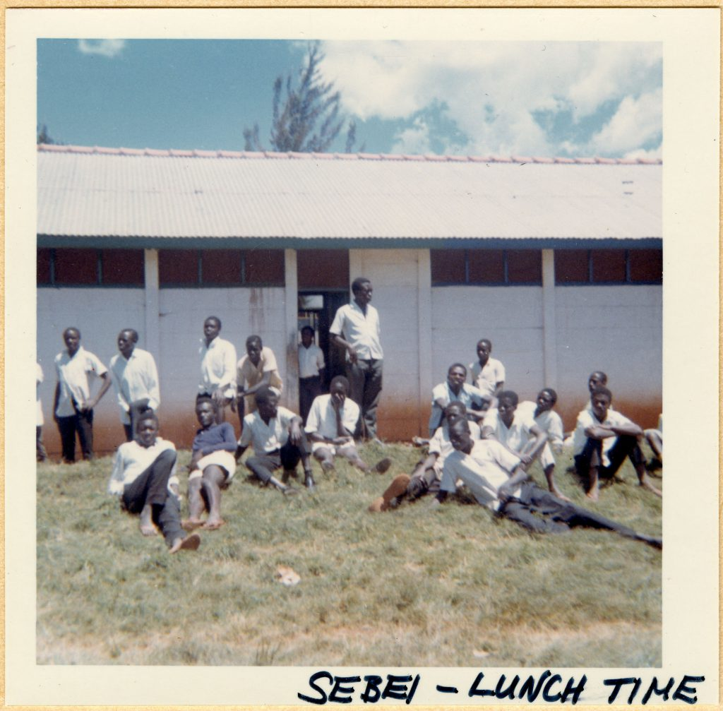 Charlotte Daigle Berney taught at Seibei College in Uganda. Pictured here, students relax outside during lunchtime.