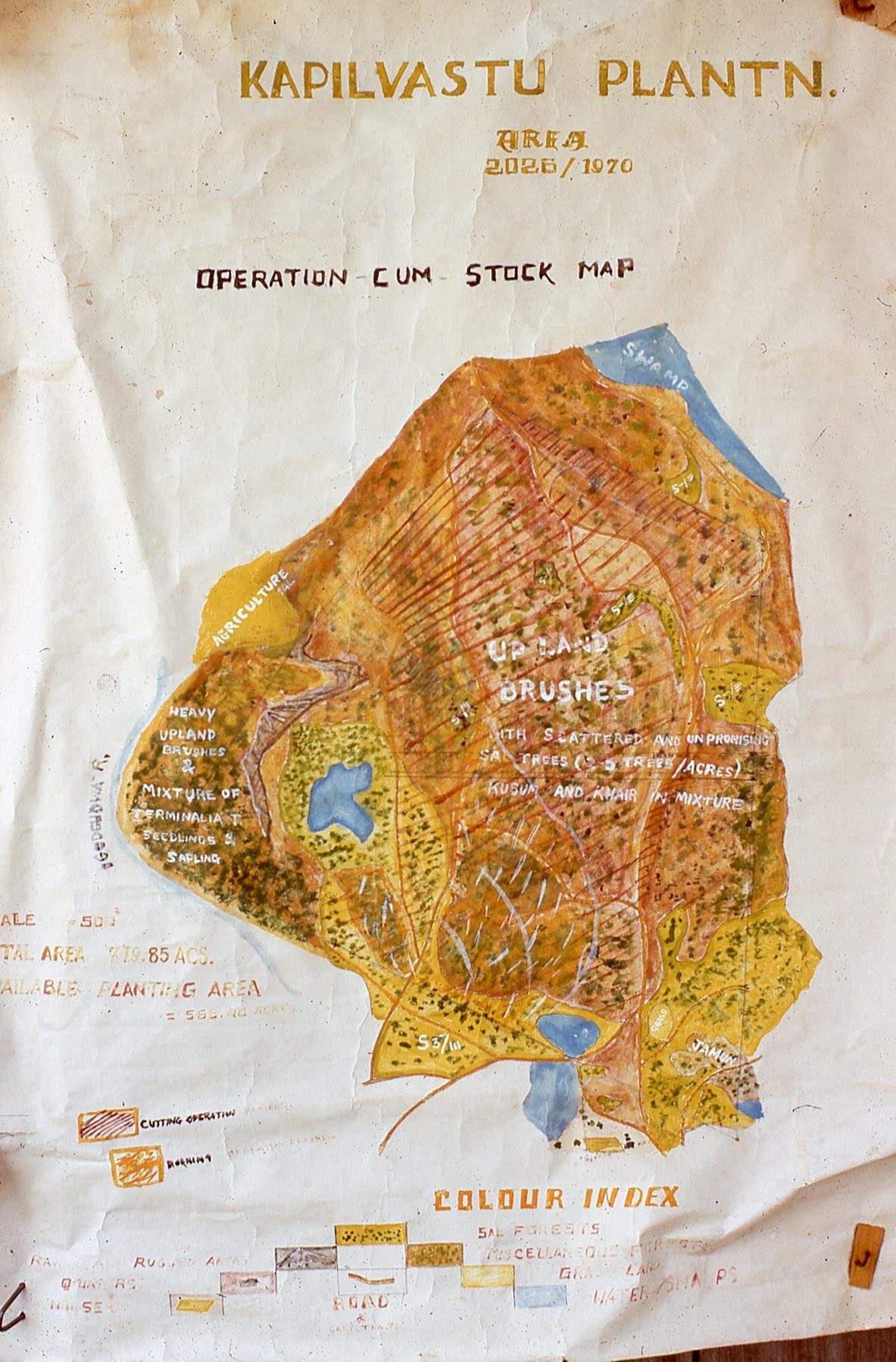"Agricultural map reads ""Operation Cum Stock Map,"" and outlines trees, water sources, and topographical landmarks."